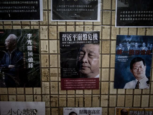In this photograph taken on January 4, 2016 posters of books about China's politics including some featuring Chinese President Xi Jinping are displayed in the staircase leading to a bookshop in Hong Kong. (AFP/Philippe Lopez)