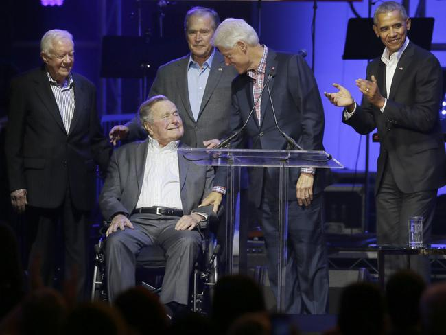 Jimmy Carter (far left) appeared at a hurricane relief concert over the weekend with former US Presidents, George HW Bush, George W Bush, Bill Clinton and Barack Obama. Picture: AP/LM Otero