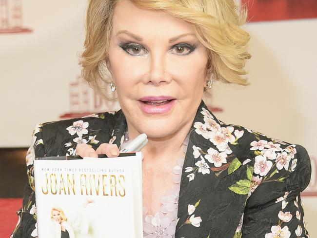 "Book tour ... Joan Rivers promotes ""Diary Of A Mad Diva"" at a New Jersey bookstore on July 1, 2014."