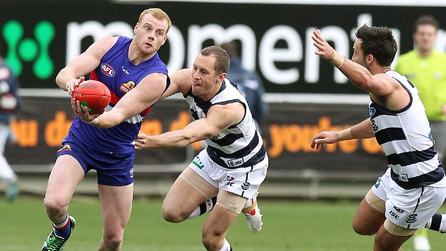 Geelong vs Western Bulldogs at Simonds Stadium. Adam Cooney clears out of the middle Picture: Michael Klein