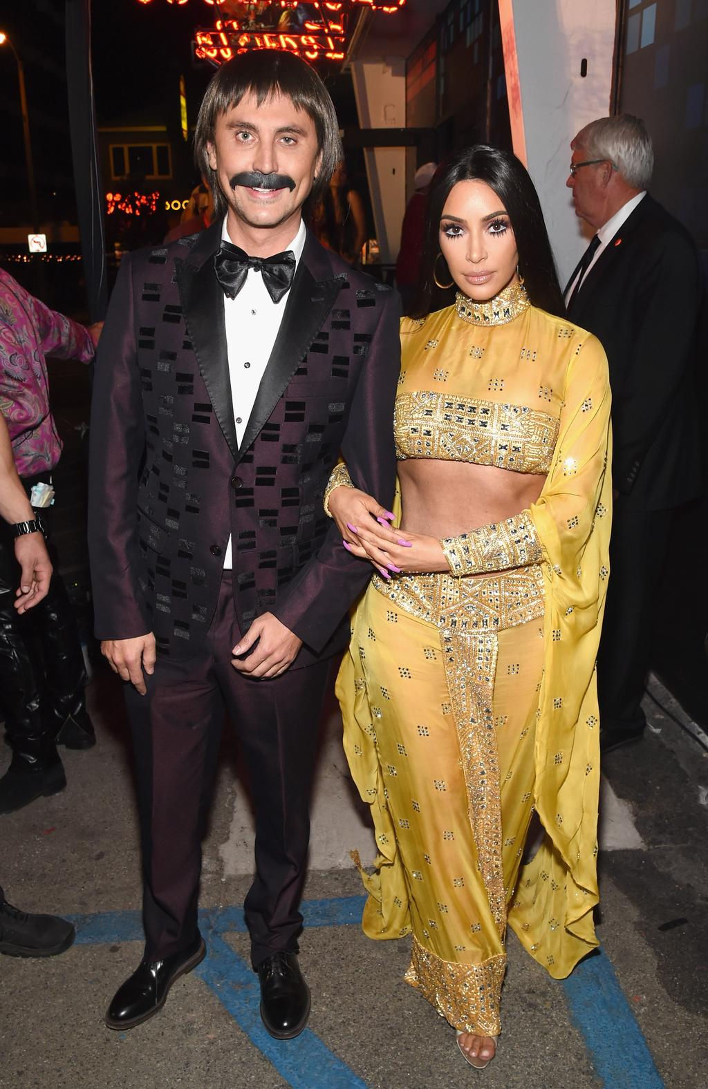 Jonathan Cheban (L) and Kim Kardashian attend Casamigos Halloween Party as Sonny and Cher. Picture: Michael Kovac/Getty Images for Casamigos Tequila