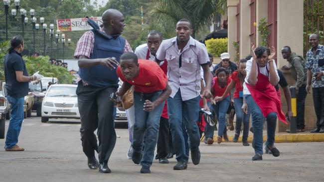 Civilians who had been hiding inside during the gunbattles manage to flee from the Westgate Mall in Nairobi.