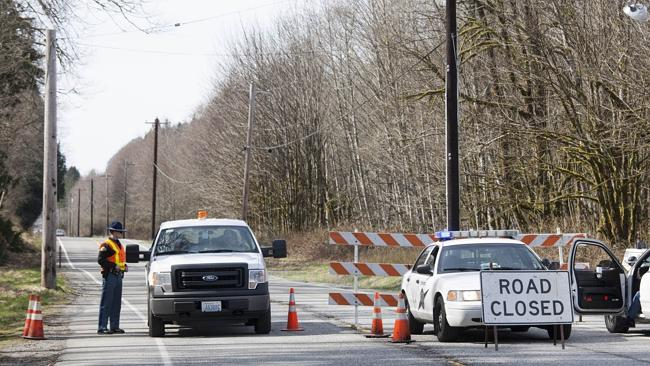 No-go zone ... Police at a roadblock on Washington state Route 530 Picture: David Ryder/G
