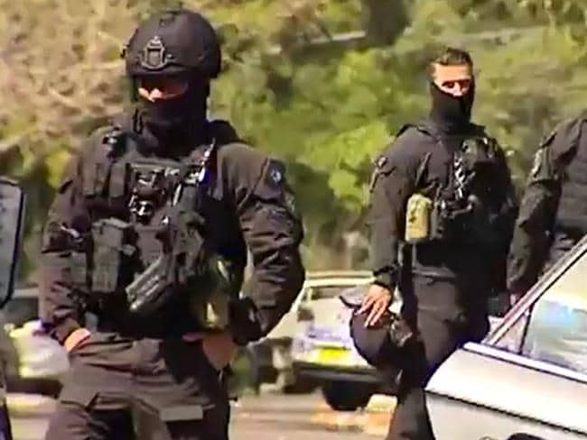 Heavily-armed police arrested four men today in Cremorne. Picture: Seven News