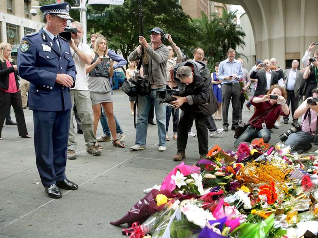 Police Commissioner Andrew Scipione at the Martin Place flower memorial. Governor-general Peter Cosgrove and NSW Premier Mike Baird have also paid tribute at the scene.
