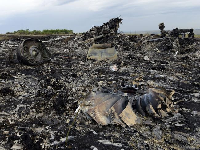 Crash site ... Debris lies at the site of the crash of the Malaysia Airlines plane carrying 298 people from Amsterdam to Kuala Lumpur in Grabove, in rebel-held east Ukraine. Pic: ALEXANDER KHUDOTEPLY