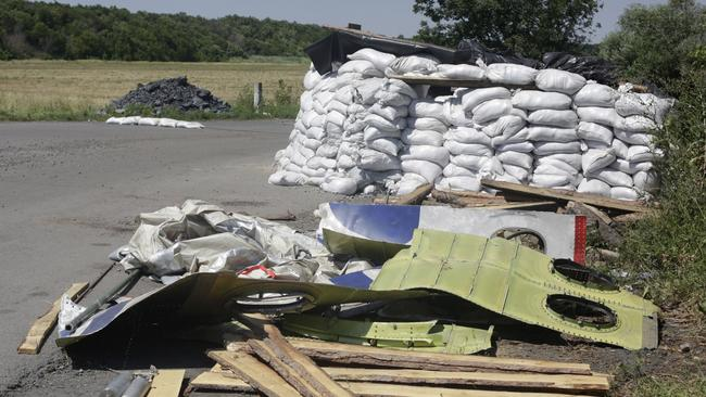 Plane debris ... parts of the crashed Malaysia Airlines Flight MH17 are pictured at the checkpoint of pro-Russian militants in Rassypnoye village.