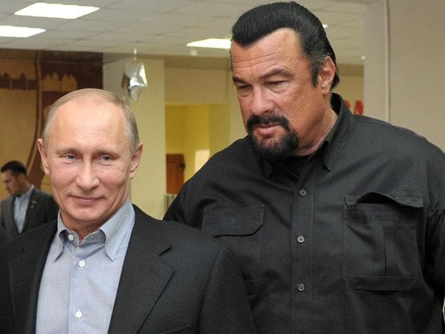 Besties: Vladimir Putin and Steven Seagal have bonded over their love of martial arts. Pic: Alexei Nikolsky.