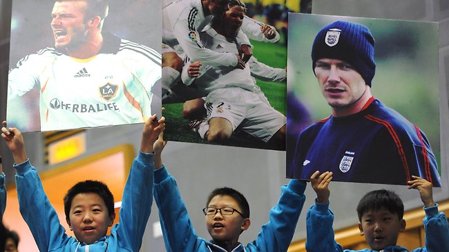 BECKS IN BEIJING . Football superstar David Beckham draws big crowds on a visit to a middle school in Beijing as part of a a five-day tour as the China Football Association's first international ambassador. Picture: Wang Zhao