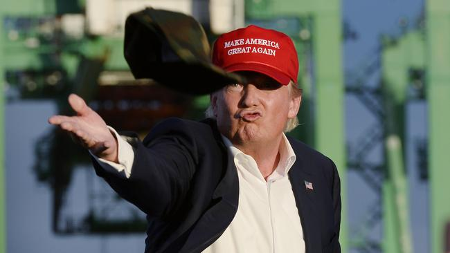 Republican presidential candidate Donald Trump signals his mood through his headwear.