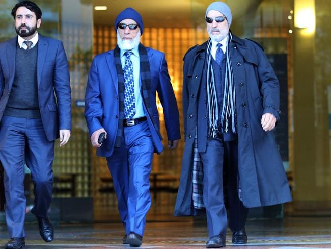 Poor immigrants turned millionaires, Ibrahim (centre) and Mamdouh (right) Elomar face up to ten years prison for corporate bribery. Picture Craig Greenhill