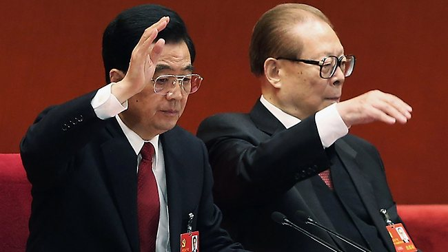 Chinese President Hu Jintao and former president Jiang Zemin vote at the closing of the 18th Communist Party Congress at the Great Hall of the People in Beijing.