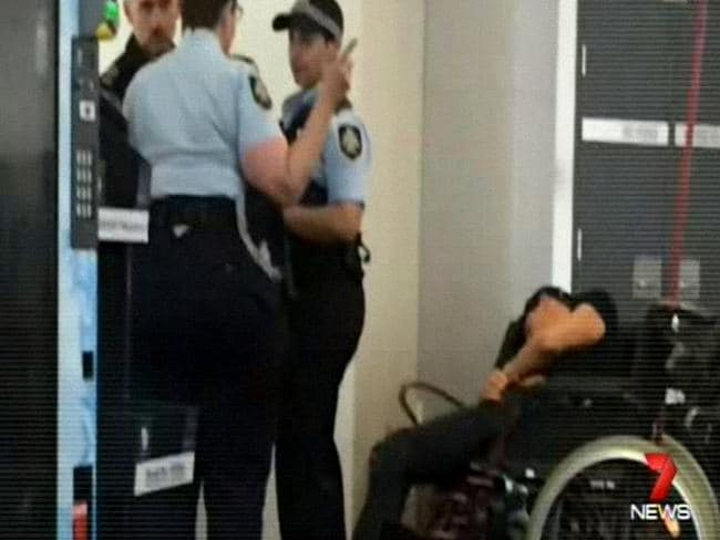 A man reported to be Grant Hackett slumped in a wheelchair. Picture: Channel 7