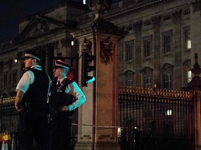 Police officers stand guard at a police cordon next to Buckingham Palace. Picture: AFP/Chris J Ratcliffe
