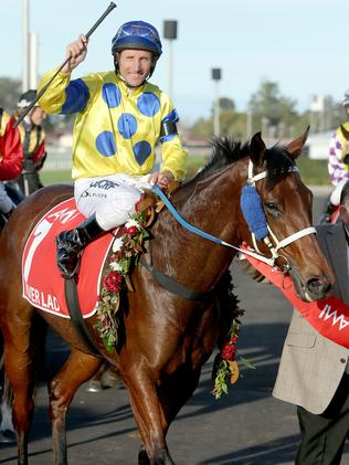 Damien Oliver and River Lad after winning this year's Stradbroke Handicap. Picture: Mark Cranitch