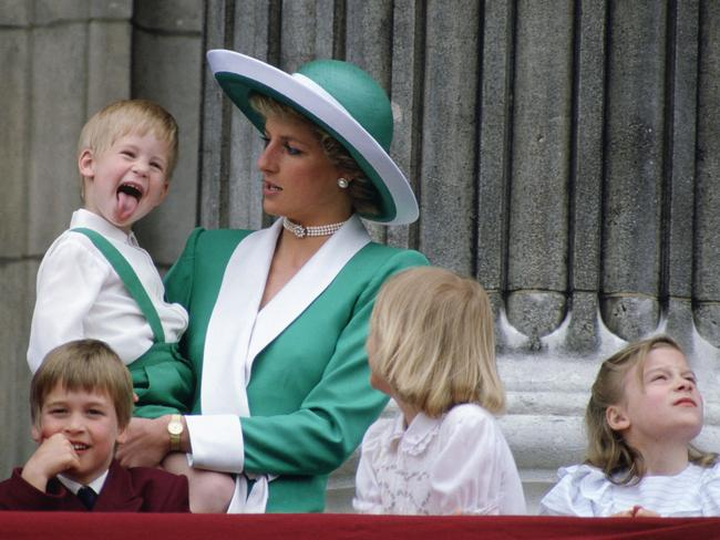Sign of respect ... Prince William (front) would like to name a daughter after his mother Diana - pictured holding Prince Harry at Buckingham Palace. Picture: Tim Graham