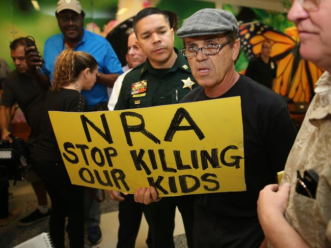 People protest against the National Rifle Association at the Broward County Court House during the first appearance in court via video link for high school shooter Nikolas Cruz February. Picture: AFP