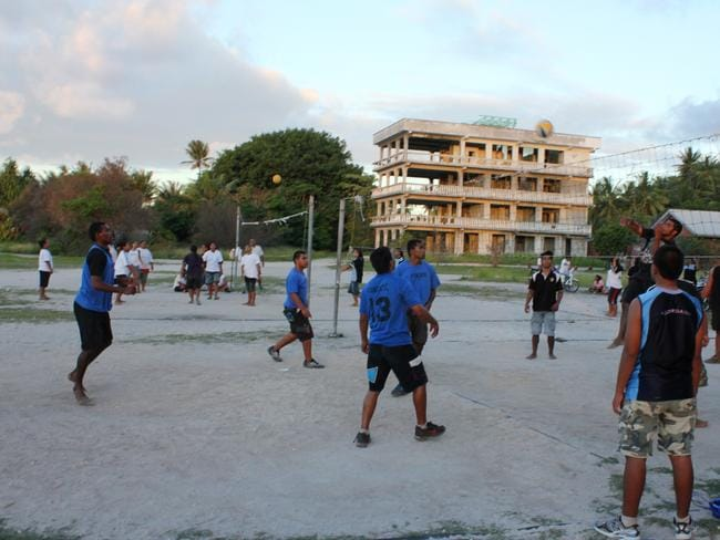 Locals enjoy a game of volleyball. Picture: DFAT
