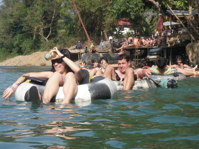 Tourists tube down the river in Vang Vieng. Picture: Tom Bishop