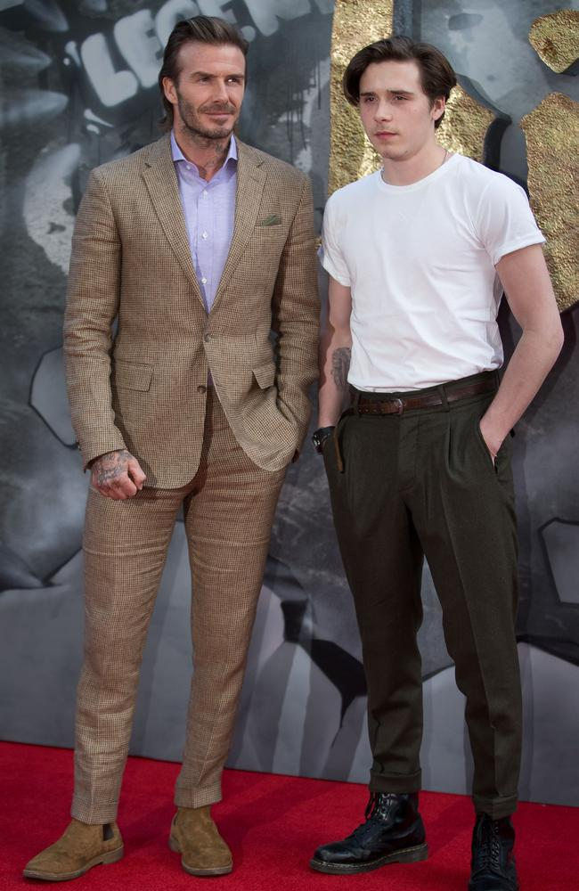 Brooklyn Beckham, right, seems to have taken fashion lessons from his father, David (left).