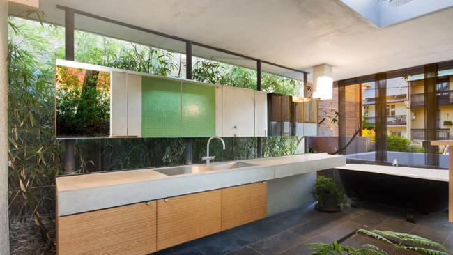 It's hard to tell where the garden ends and the bathroom begins in this beautiful house in New South Wales, where infinite space is the order of the day. Architect: Drew Heath Architects. Picture: Matt Craig.
