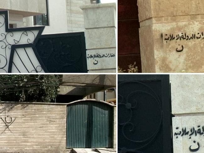 "Mark of terror ... A combination of image grabs taken from a video shows graffiti with the first letter of the world ""Nasara"", the word used in the Koran for Christians, tagged on the wall of a church (top left and bottom right) and on houses in the Iraqi city of Mosul."