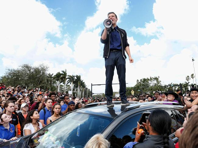 Majory Stoneman High School student Cameron Kasky addresses area High Schoolstudents as they rally in Parkland, Florida. Picture: AFP