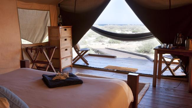 The view out across the dunes from within a luxury Sal Salis tent at Ningaloo Reef.Picture: James Morgan
