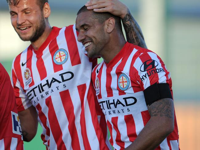 Patrick Kisnorbo (R) of Melbourne City celebrates with teammate Jason Hoffman after scoring.