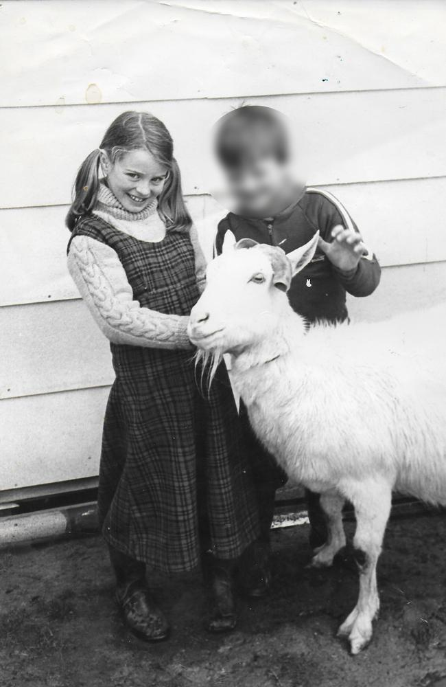 Claire and one of her siblings, as a child.