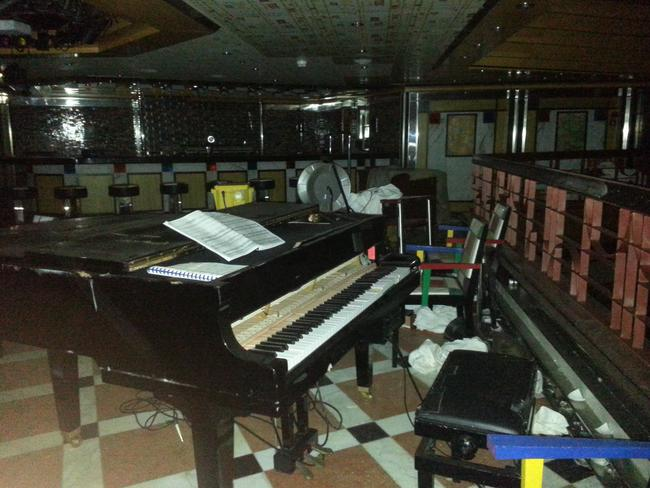 Recovered from the deep ... a piano inside one of the bars on the Costa Concordia. Picture: Australpress