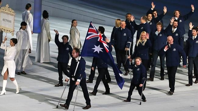 Cameron Rahles-Rahbula leads the Aussies during the opening ceremony.