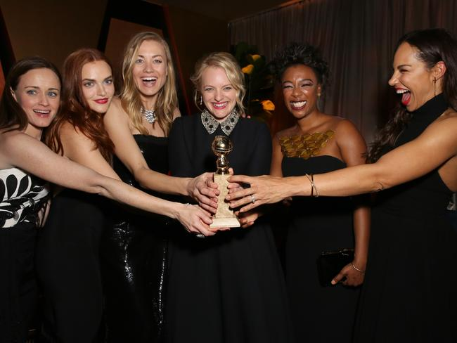 This year, starts partied in black with Weinstein's presence felt by his absence. Pictured, actors Alexis Bledel, Madeline Brewer, Yvonne Strahovski, Elisabeth Moss, Samira Wiley and Amanda Brugel attend Hulu's 2018 Golden Globes After Party at The Beverly Hilton Hotel. Picture: Photo by Rachel Murray/Getty Images for Hulu.
