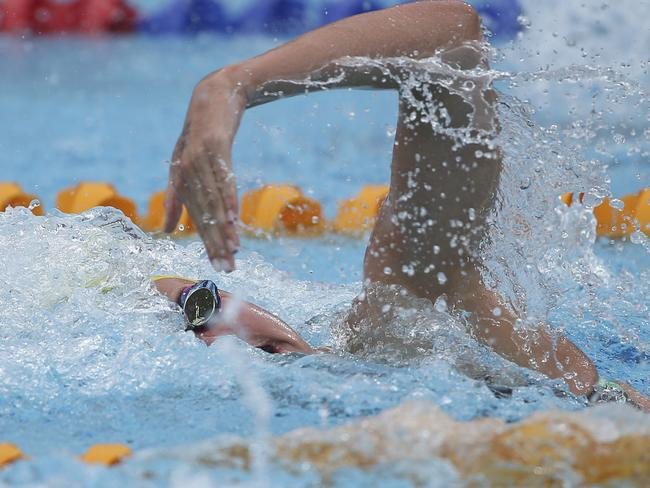 Cate Campbell swims in her women's 100m freestyle heat at the Pan Pacific swimming championships on Friday.