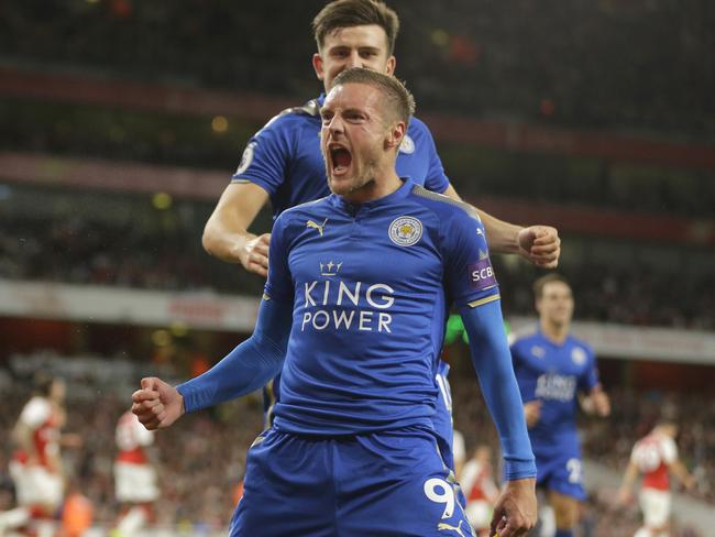 Leicester City's Jamie Vardy, centre celebrates with teammates after scoring his sides third goal.