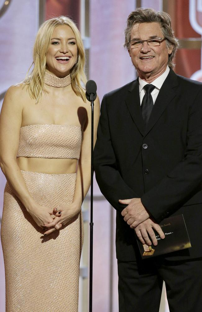 Presenters Kate Hudson and Kurt Russell speak onstage during the 73rd Annual Golden Globe Awards at The Beverly Hilton Hotel on January 10, 2016 in Beverly Hills, California. (Photo by Paul Drinkwater/NBCUniversal via Getty Images)