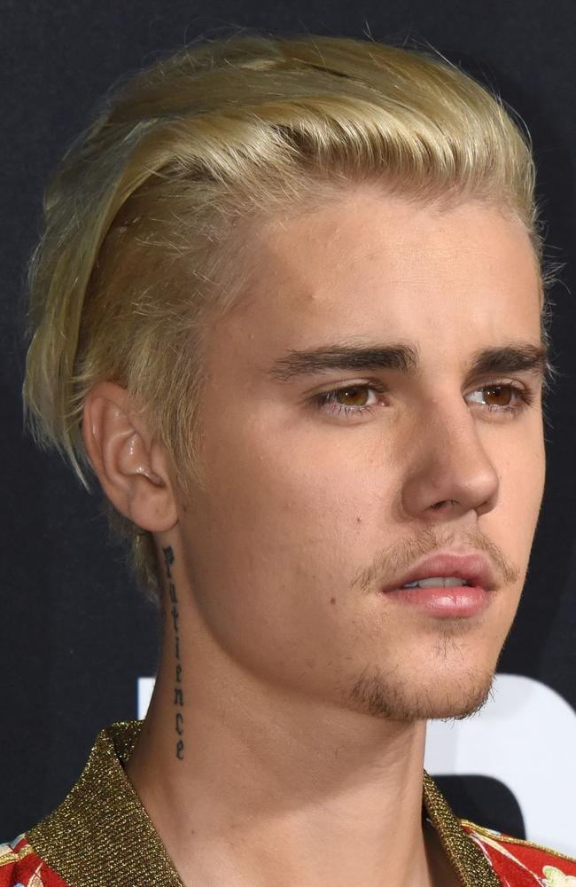 Justin Bieber's fans fell for online trolls back in 2013 who encouraged self-harming to 'stop him' from smoking marijuana. (AFP PHOTO/ROBYN BECK)