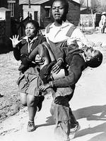 His young sister, L, screams out her grief, as a fellow student carries the body of Hector Petersen toward a waiting car in the Soweto section of Johannesburg, South Africa. Petersen was slain by police bullets in a bloody riot on 16th June 1976, in which police battled 10,000 black high school students in the segregated township after pupils went on a rampage to protest the mandatory use of the Afrikaans language in the schools.(AP Photo/Argus, files) b/w /south africa - race relations /apartheid