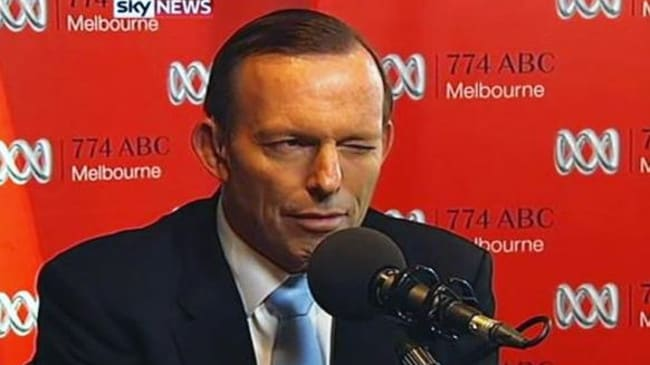 One eye off the ball ... the PM Abbott winks as sex line worker Gloria introduces herself. His media advisors presumably groan. Picture courtesy of Sky News.