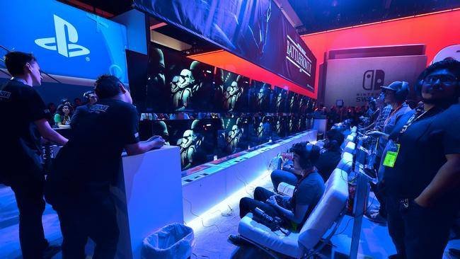Gaming fans play  <i>Star Wars Battlefront II</i> from EA Sports at the Los Angeles Convention Center.