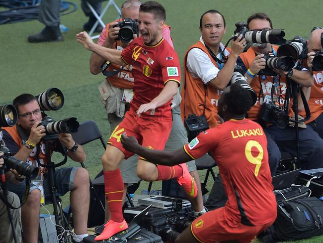 Belgian substitute Dries Mertens and his teammate Romelu Lukaku celebrate after scoring the winner against Algeria.