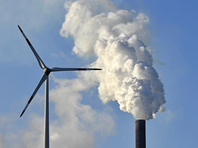 A coal-burning power plant steams behind wind generators in Gelsenkirchen, Germany. Picture: Martin Meissner