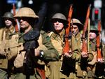 Men dressed as WWI soldiers take part in an Anzac Day parade in Brisbane, Wednesday, April 25, 2018. Anzac Day is a national day of remembrance to commemorate the service and sacrifice of Australian service men and women. (AAP Image/Dan Peled) NO ARCHIVING