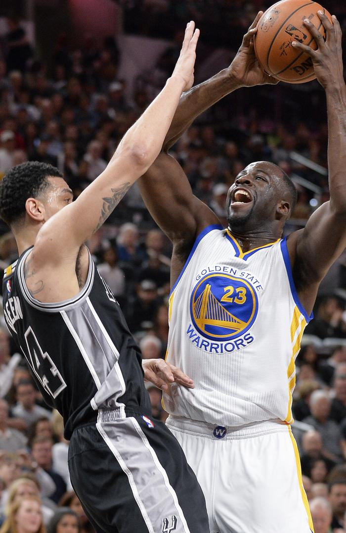Golden State Warriors forward Draymond Green shoots against San Antonio Spurs guard Danny Green during the first half.