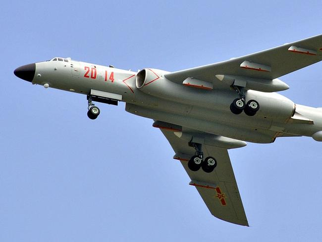 "Vintage wings ... The Chinese H-6K strategic bomber is based on an old Russian 1950s design, the ""Badger""."