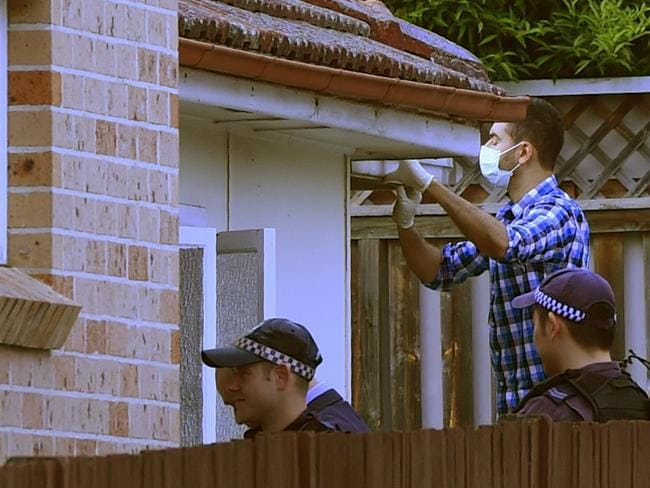The Guildford home was targeted by a number of police who descended on the street. Picture: AAP