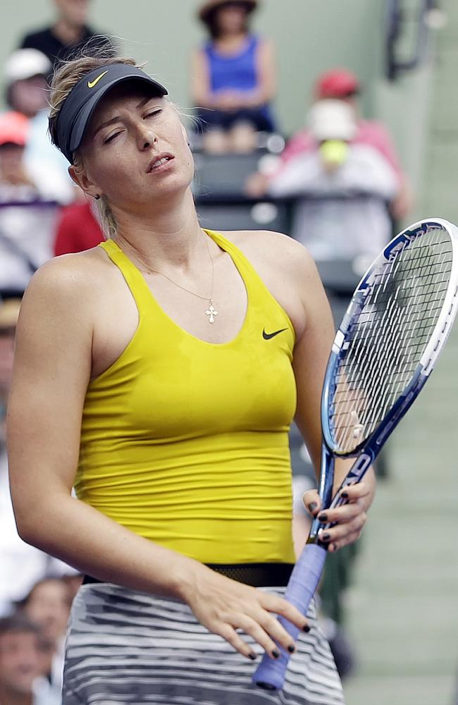 Maria Sharapova, of Russia, reacts after losing a point to Serena Williams at the Sony Open Tennis tournament.