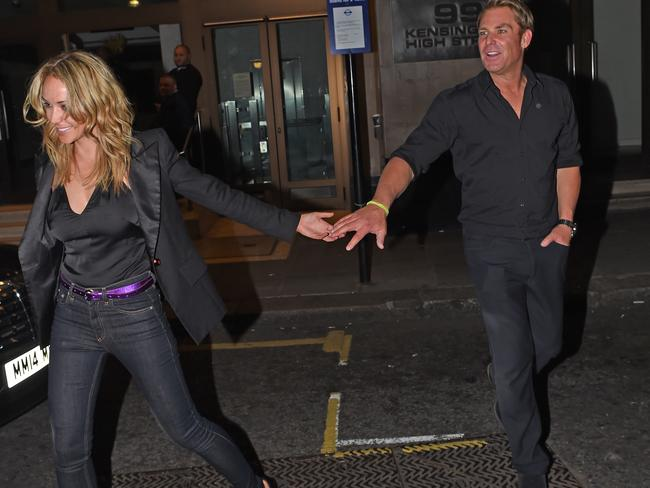 Shane Warne and Emily Scott looked very much a couple at the Coldplay conert.