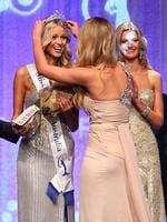 <p>Scherri-Lee Biggs (C) crowns Renae Ayris (L) of Western Australia as runner-up Mary Vitinaros (R) looks on during the crowning ceremony to announce the 2012 Miss Universe Australia at the Sofitel Melbourne on Collins on June 8, 2012 in Melbourne, Australia. (Photo by Scott Barbour/Getty Images)</p>