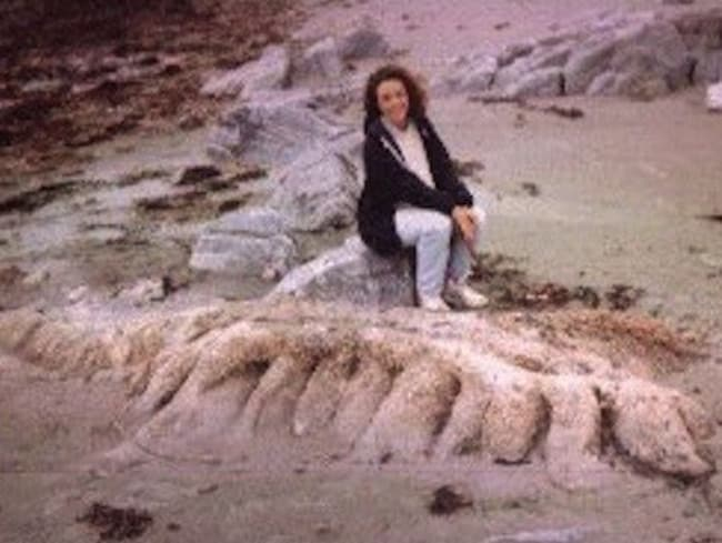 Louise Whitts poses with the creature she found on Benbecula Beach in 1998.